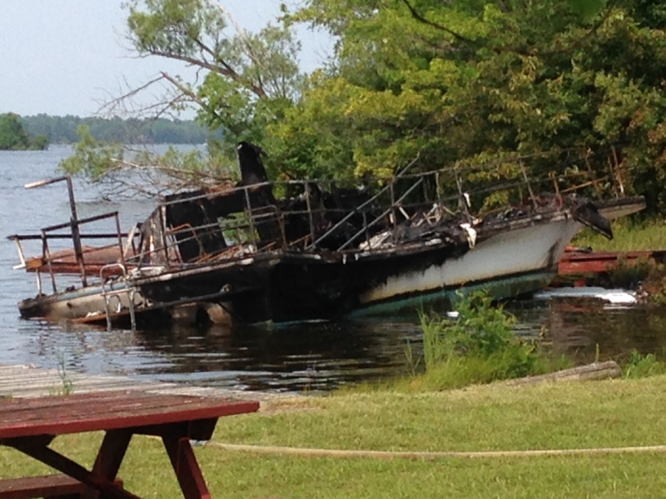 A house boat damaged by a fire at the Starport Marina in Port Severn, Ont. can be seen on Sunday, July 5, 2015. (Sara Reimer)