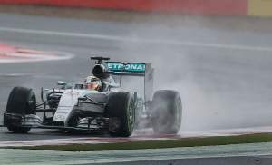 British Mercedes driver Lewis Hamilton steers his car through the rain during the British Formula One Grand Prix at Silverstone circuit, Silverstone, England, Sunday, July 5, 2015. (AP / Frank Augstein)