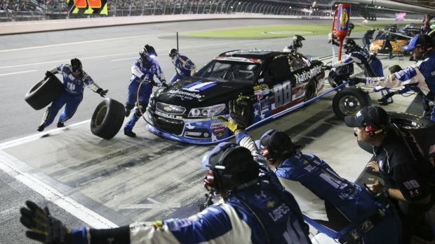 Dale Earnhardt Jr. pits for fuel and tires during a NASCAR Sprint Cup series auto race at Daytona International Speedway in Daytona Beach, Fla. on July 6, 2015. (AP / Alex Menendez)