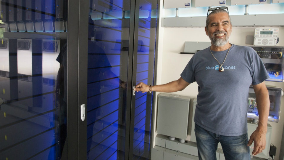 Henk Rogers, who manages the worldwide rights to the video game Tetris, opens his solar-powered battery unit that he uses to remain off the electrical grid in Honolulu on June 30, 2015. (AP / Caleb Jones)