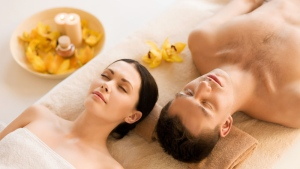 A couple relax in a spa. (Syda Production / Shutterstock)