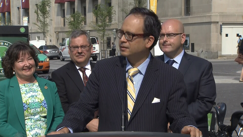 Coun. Denzil Minnan-Wong speaks to reporters at a news conference in Toronto on Monday, July 6, 2015.