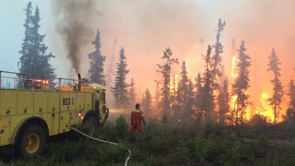 A crew fights a wildfire in the La Ronge, Sask., on Saturday, July 4, 2015. (Government of Saskatchewan)