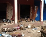 In this photo taken on a mobile phone, debris lays strewn over the area after a bomb exploded at a mosque in Jos, Nigeria on Monday, July 6, 2015. (AP Photo)