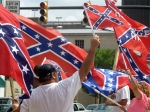 Supporters of keeping the Confederate battle flag flying at a Confederate monument at the South Carolina Statehouse wave flags during a rally in front of the statehouse in Columbia, S.C., on Saturday, June 27, 2015. (AP / Bruce Smith)