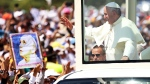 Pope Francis waves from the Popemobile as he arrives to celebrate a Mass in in Samanes Park, in Guayaquil, Ecuador, Monday, July 6, 2015. <br> <br> Francis traveled to Ecuador to celebrate Mass with hundreds of thousands of faithful. (AP / Fernando Vergara)