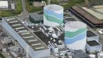 This aerial photo shows reactors of No. 1, right, and No. 2 at the Sendai Nuclear Power Station in Satsumasendai, Kagoshima prefecture, southern Japan, Tuesday, July 7, 2105. (Hiroko Harima / Kyodo News)