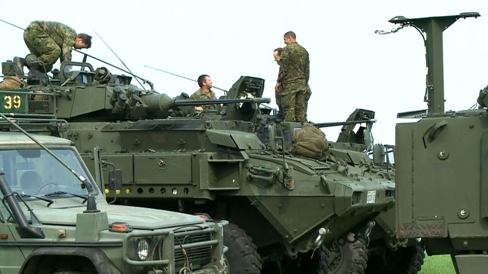 Canadian soldiers are seen in Prince Albert, before being deployed to fight fires in Saskatchewan, Monday, July 6, 2015.