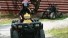 FILE - Teens ride an ATV (All Terrain Vehicle) near Lakefield, Ont., on Aug.3, 2009. (THE CANADIAN PRESS/Richard Buchan)