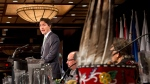 A First Nations headdress sits on a table as Federal Liberal Leader Justin Trudeau addresses the Assembly of First Nations congress in Montreal on Tuesday, July 7, 2015. (Ryan Remiorz / THE CANADIAN PRESS)