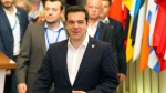 Greek Prime Minister Alexis Tsipras, centre, leaves after an emergency summit of eurozone heads of state and government in Brussels on Tuesday, July 7, 2015. (AP / Michel Euler)