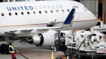 A worker prepares to fuel a United Express aircraft after it arrived at Dallas-Fort Worth International Airport, in Grapevine, Texas, Jan. 15, 2015. (AP / Tony Gutierrez)