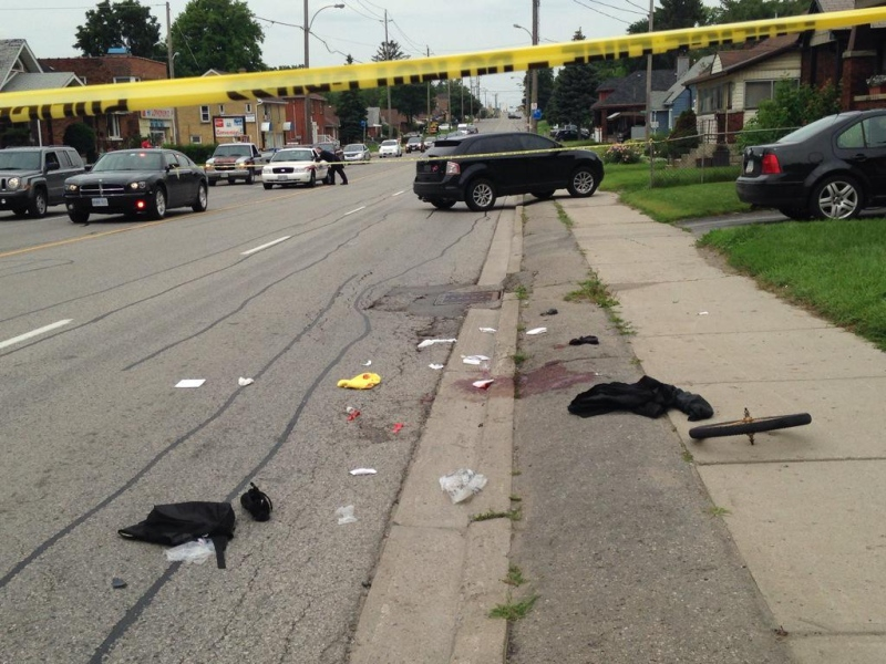 Police block a section of Highbury Avenue after a cyclist was struck in London, Ont. on Wednesday, July 8, 2015. (Colleen MacDonald / CTV London)