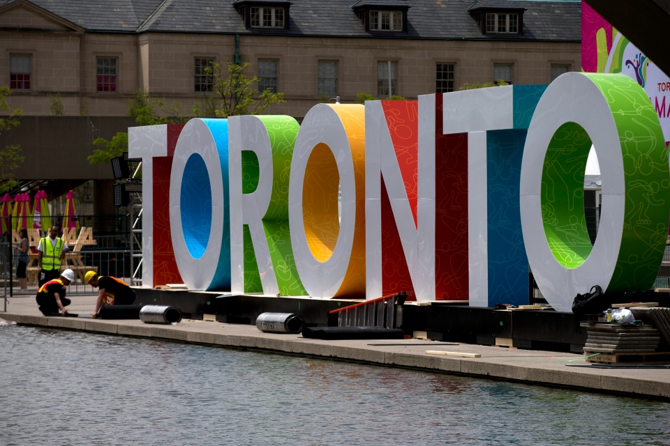 Workers erect giant letters spelling out Toronto in Nathan Phillips Square as they prepare for the Pan Am Games, Wednesday, July 8, 2015. (AP / Rebecca Blackwell)