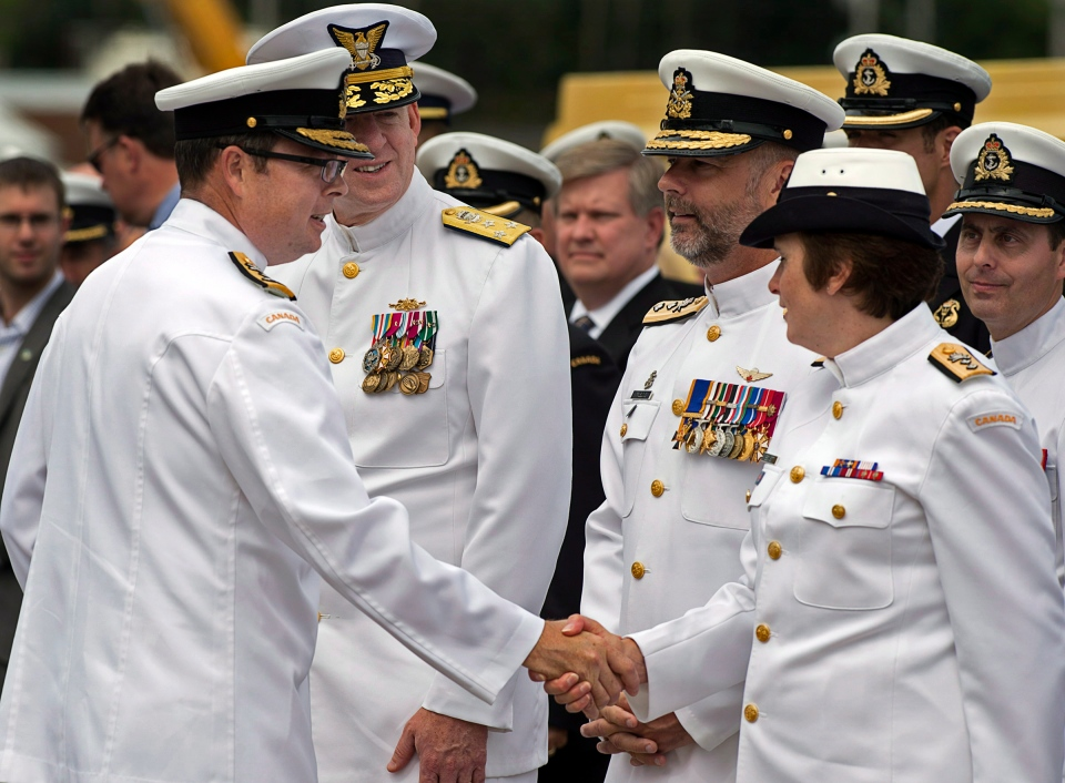 Vice Admiral Mark Norman, left, greets officers at a change of command ceremony in Halifax on Friday, July 12, 2013. (Andrew Vaughan/The Canadian Press)