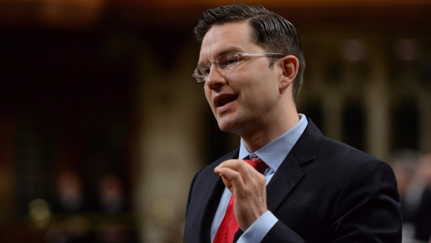 Pierre Poilievre, Minister of Employment and Social Development, speaks in the House of Commons, on Friday, June 12, 2015. (THE CANADIAN PRESS/Sean Kilpatrick)