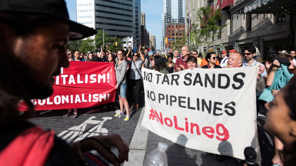Demonstrators protest outside of the Climate Summit of the Americas in Toronto on Wednesday, July 8, 2015. (Darren Calabrese / THE CANADIAN PRESS)
