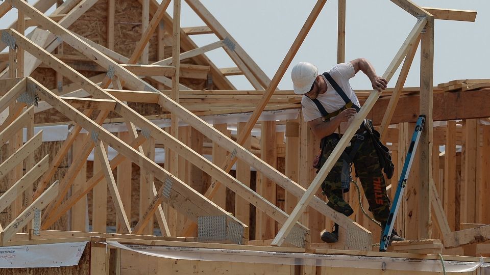 Construction workers build new homes in a development in Ottawa on Monday, July 6, 2015. (Sean Kilpatrick / THE CANADIAN PRESS)