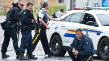 Searching for a gunman in Moncton on June 5, 2014