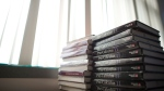 A pile of pre-calculus books are pictured stacked on top of a desk in Vancouver, B.C. Friday, Sept. 5, 2014. (Jonathan Hayward / THE CANADIAN PRESS)