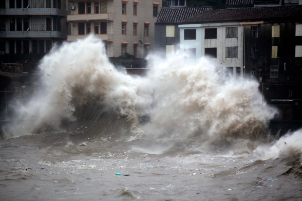 Cancelled flights, mass evacuations as typhoon hits ...