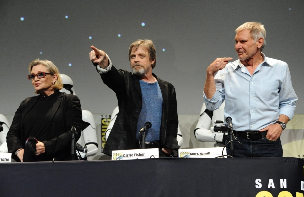 Carrie Fisher, from left, Mark Hamill, and Harrison Ford attend Lucasfilm's 'Star Wars: The Force Awakens' panel on day 2 of Comic-Con International, in San Diego, Calif. on Friday, July 10, 2015. (AP / Richard Shotwell)