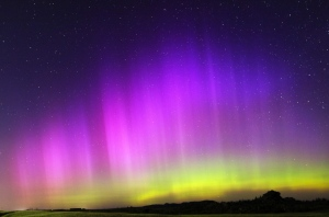 The Aurora Borealis, also known as the Northern Lights, begin to flare up with green, yellow and pink hues near the Vedauwoo Recreation Area late Monday night between Cheyenne and Laramie, Wyo. (Blaine McCartney/Wyoming Tribune Eagle)