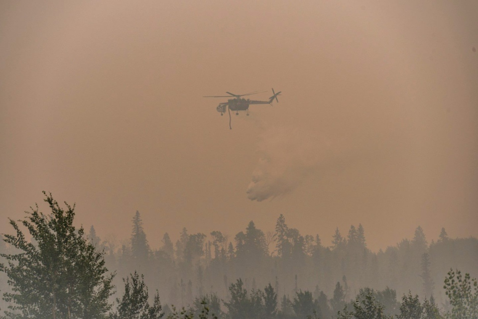 """""""Shania"""" drops fire retardant on a wildfire in the La Ronge, Sask. area in this July 9, 2015 handout photo. (Saskatchewan Ministry of the Environment / Corey Hardcastle / The Canadian Press)"""