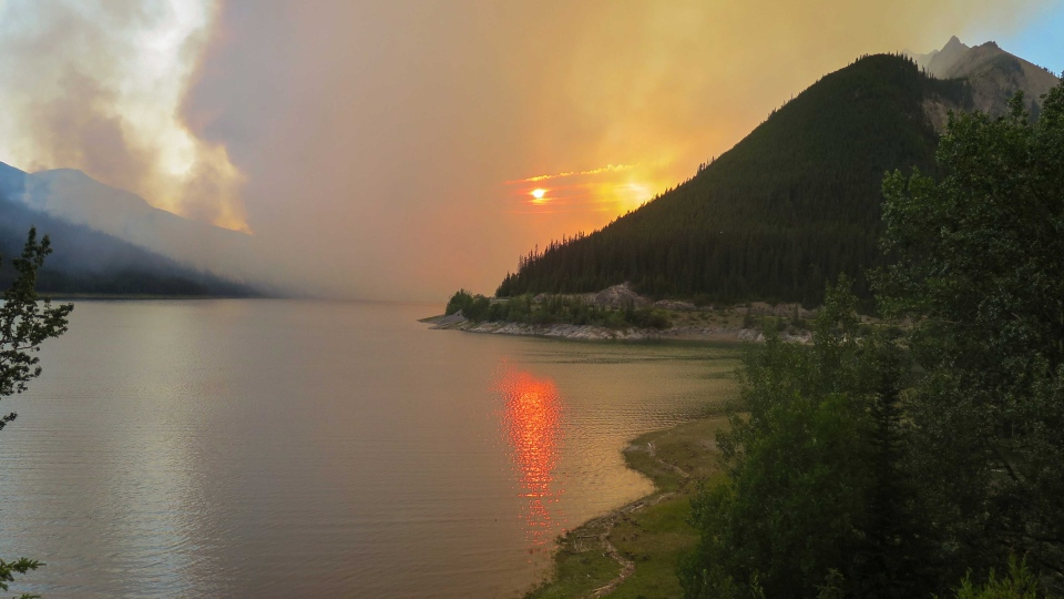 Smoke from the Excelsior Creek wildfire is shown at sunset in Jasper National Park on Friday July 10, 2015. An evacuation of part of Jasper National Park has been ordered due to a forest fire in the picturesque Maligne Valley. (THE CANADIAN PRESS/Parks Canada-Wildlife Guardians)