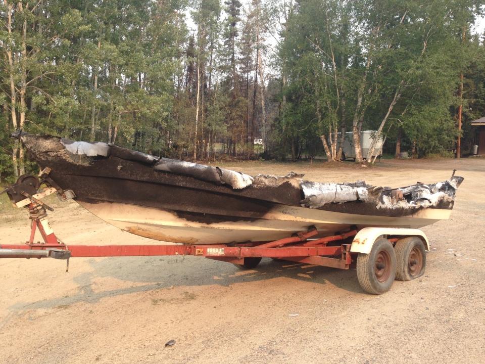 A fire-damaged boat in Waden Bay, Saskatchewan on Saturday July 11 (Gareth Dillistone/CTV News)