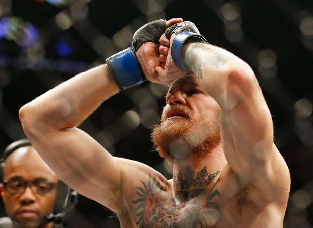 Conor McGregor celebrates after defeating Chad Mendes in their interim featherweight title mixed martial arts bout at UFC 189 Saturday, July 11, 2015, in Las Vegas. (AP/John Locher)