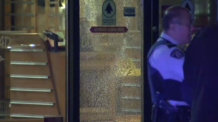 The bakery's front door was shattered by the shooting (CTV).