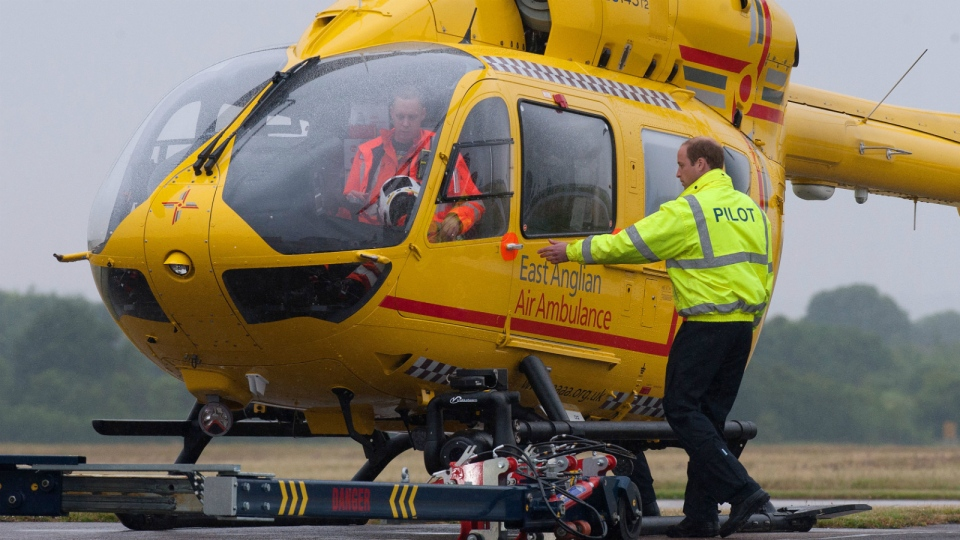 Prince William, the Duke of Cambridge prepares to board an East Anglian Air Ambulance (EAAA) at Cambridge Airport, Cambridge, in England on July 13, 2015. (AP / Stefan Rousseau)