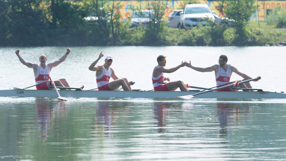 Canadians, left to right, Will Crothers, Tim Schrijver, Kai Langerfeld, and Conlin McCabe celebrate after winning gold in the the men's coxless four final at the 2015 Pan Am Games at the Royal Canadian Henley Rowing Course in St. Catharines, Ont., on Monday, July 13, 2015. (Peter Power / THE CANADIAN PRESS)