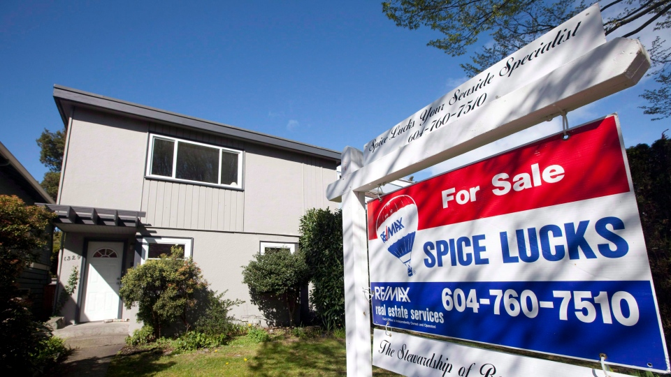 A for sale sign sits outside a home in Vancouver, on April 8, 2010. (Jonathan Hayward/The Canadian Press)