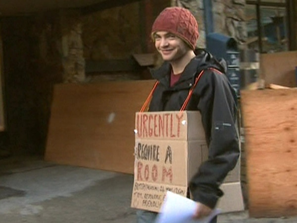 Matt Telfer is advertising his housing plight on a sandwich board-styled cardboard box.