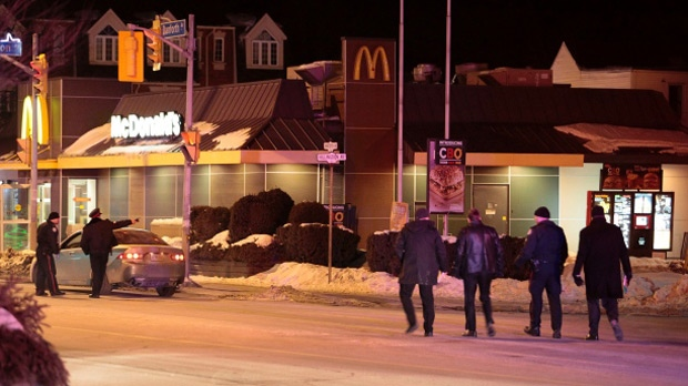 Police attend the scene of a shooting at a McDonald's on Danforth Avenue in Toronto on Saturday, Feb. 28, 2015. (John Hanley / CTV Toronto)