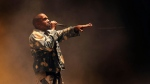 Kanye West performs on the main Pyramid stage during the Glastonbury music festival at Worthy Farm, Glastonbury, England, on June 27, 2015. Kanye West will perform at the closing ceremony of the Pan American Games in Toronto. The multi-sport event's organizing committee confirmed today that the music superstar will perform at the closing ceremony on July 26. He will be joined by Canadian singer Serena Ryder and Cuban-American rapper Pitbull. THE CANADIAN PRESS/AP, Invision - Joel Ryan