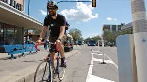 A cyclist makes use of the new 23rd Street bike lane in Saskatoon on Wednesday, July 15, 2015.