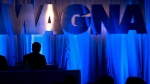 Donald J. Walker, chief executive officer of Magna International Inc., is silhouetted as he waits for the company's annual general meeting to begin in Toronto on May 10, 2013. (Nathan Denette / THE CANADIAN PRESS)