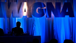 Donald J. Walker, CEO of Magna International Inc., is silhouetted as he waits for the company's annual general meeting to begin in Toronto on May 10, 2013. (Nathan Denette / THE CANADIAN PRESS)