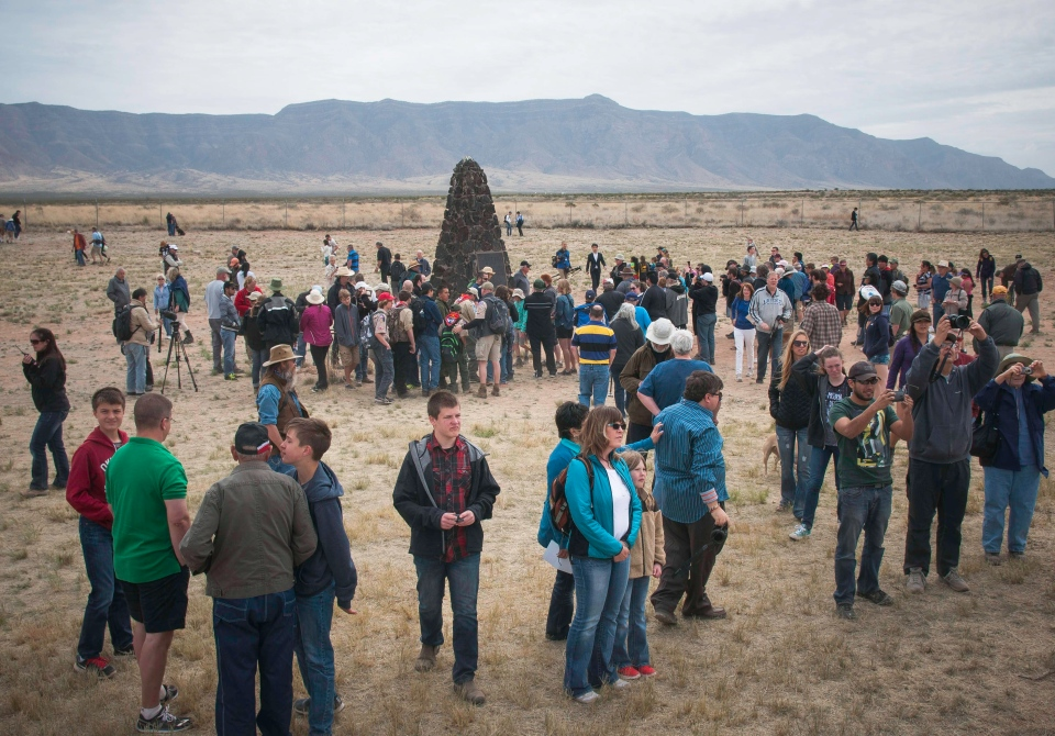 Visitors assemble Saturday, April 4, 2015, at the White Sands Missile Range newly opened Trinity Site to the public for an open house commemorating the 70th anniversary of the first atomic test which took place there on July 16, 1945. (AP / The Las Cruces Sun-News / Jett Loe)