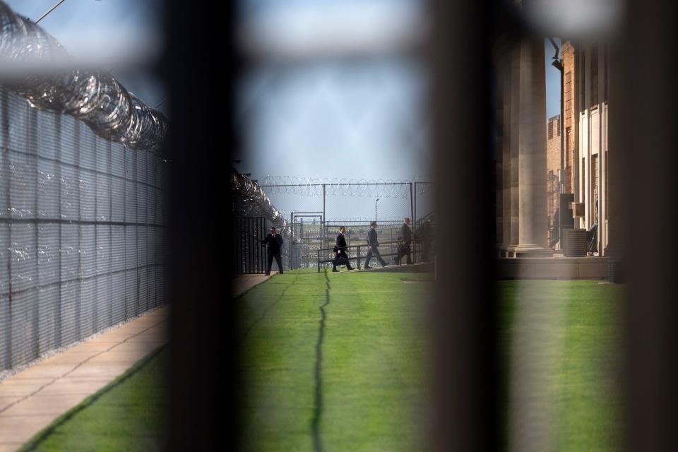 White House staff walk into the El Reno Federal Correctional Institution in El Reno, Okla., Thursday, July 16, 2015. (AP/Evan Vucci)