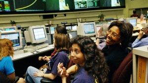 Claudia Alexander, right, project manager for Galileo, waits in the mission control room in Pasadena, Calif., along with engineer Nagin Cox, centre, and others for the spacecraft to take its final plunge into Jupiter on Sept. 21, 2003. (AP / Ric Francis)