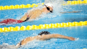 Canada's Emily Overholt swims for the bronze medal in the women's 4x200m freestyle relay final at the Pan Am Games, Thursday, July 16, 2015, in Toronto. (AP Photo/Julio Cortez)