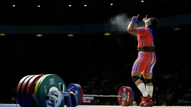 Dominican Republic's Veronica Saladin Tolentino celebrates after a successful lift attempt during the women's +75kg weightlifting competition at the Pan Am Games in Oshawa, Ontario, Wednesday, July 15, 2015. (AP / Felipe Dana)