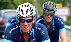 Lance Armstrong, left, and former England football international Geoff Thomas, right behind, pedal during the charity ride 'Le Tour, One Day Ahead,' Thursday, July 16, 2015, between Le Muret and Rodez, southern France. (AP/Lionel Cironneau)