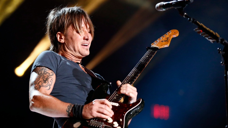 Keith Urban performs at LP Field at the CMA Music Festival on Sunday, June 14, 2015, in Nashville, Tenn. (Al Wagner / Invision)