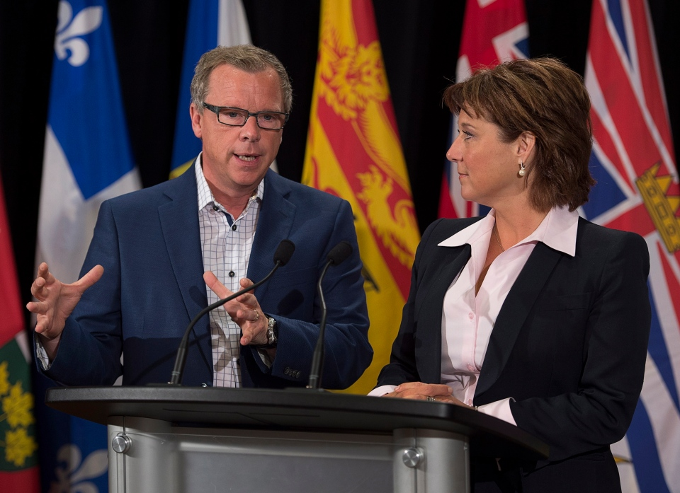 Saskatchewan Premier Brad Wall, left, and British Columbia Premier Christy Clark field questions at the summer meeting of Canada's premiers in St. John's on Friday, July 17, 2015. THE CANADIAN PRESS/Andrew Vaughan