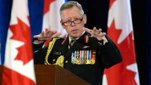 New Chief of Defence Staff Gen. Jonathan Vance gestures as he speaks during a change of command ceremony in Ottawa, Friday, July 17, 2015. (Adrian Wyld / THE CANADIAN PRESS)